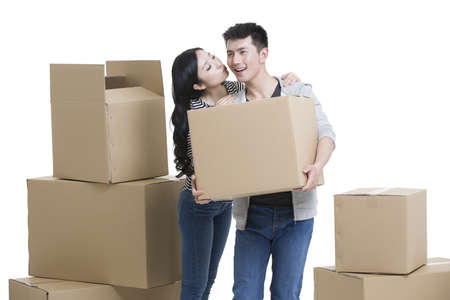 cardboard only: Young couple moving house