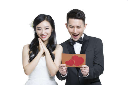 falling out: Happy bride and groom with love letter
