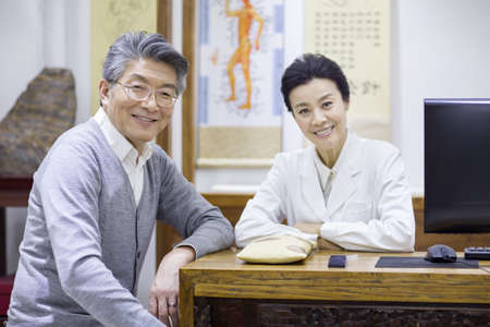 hall monitors: Female Chinese doctor and patient