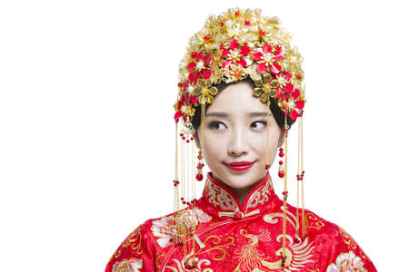 Beautiful bride in Chinese traditional wedding dress
