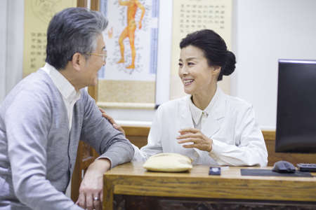 hall monitors: Female Chinese doctor talking with patient