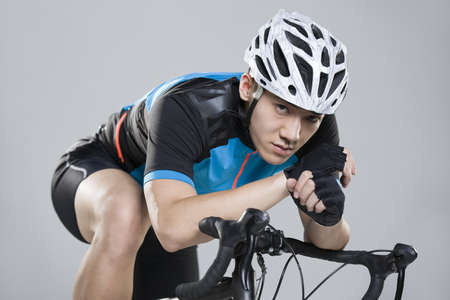 Young man riding bicycle LANG_EVOIMAGES