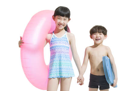 two piece swimsuit: Cute children in swimsuit with swim ring LANG_EVOIMAGES
