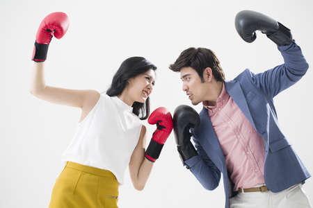 dueling: Humorous young couple