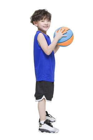 Cute boy holding a basketball