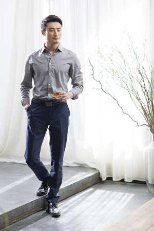 Young man enjoying fine wine
