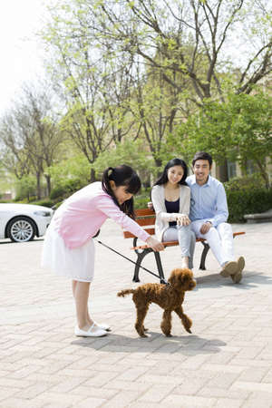 legs around: Happy young family with their pet dog