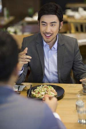 drinks after work: Chinese businessmen having dinner together LANG_EVOIMAGES