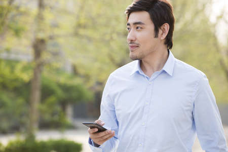 Young man holding a smart phone