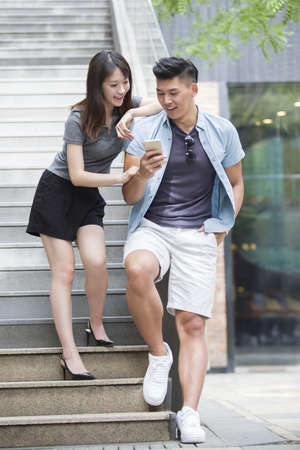 Young couple looking at a smart phone