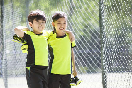chainlink fence: Happy children in sportswear