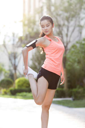 Happy young woman exercising in the morning LANG_EVOIMAGES