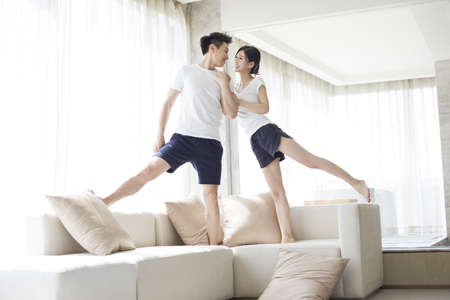 couple on couch: Happy young couple relaxing at home