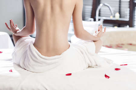 self conscious: Rear view of beautiful young woman meditating