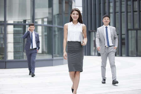 hebei: Confident business people walking outdoors