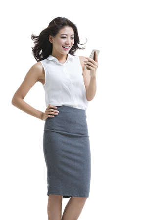 Confident young businesswoman using smart phone