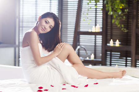 self conscious: Beautiful young woman relaxing on massage table