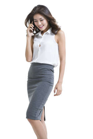 Confident young businesswoman talking on cell phone LANG_EVOIMAGES