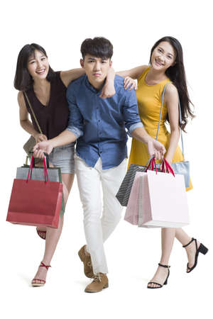 Happy young friends shopping