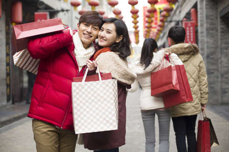 back alley: Happy young couple shopping for Chinese New Year LANG_EVOIMAGES