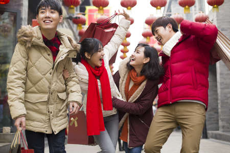 walking zone: Happy young friends shopping for Chinese New Year