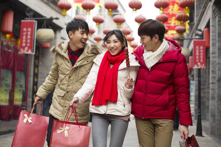 Happy young friends shopping for Chinese New Year