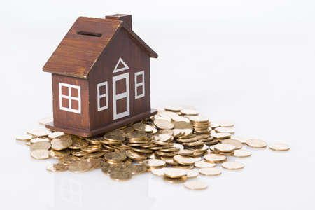 playhouse: Model house on stack of coins