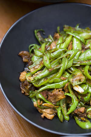 hunan: Chinese cuisine stir-fried pork with chili LANG_EVOIMAGES