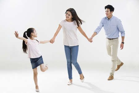 girl in full growth: Cheerful young family holding hands running
