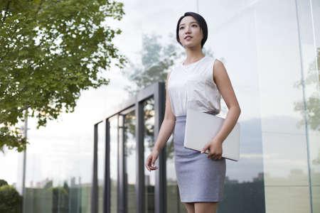 anticipation: Confident businesswoman LANG_EVOIMAGES