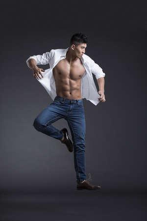 metrosexual: Young muscular man jumping
