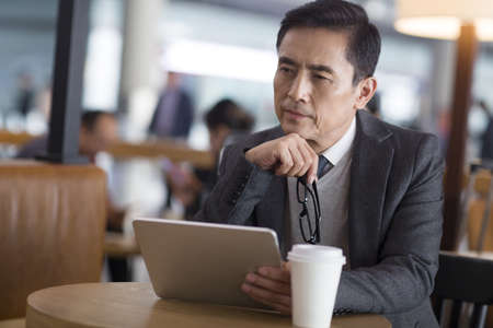 one mature man only: Businessman waiting in airport