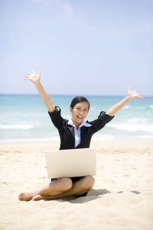 out of context: Businesswoman working on the beach