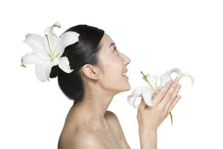 hair treatment: Beauty shot of a young woman with Lily flowers