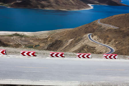 physical geography: Road and Yamdrok Yamtso lake in Tibet, China