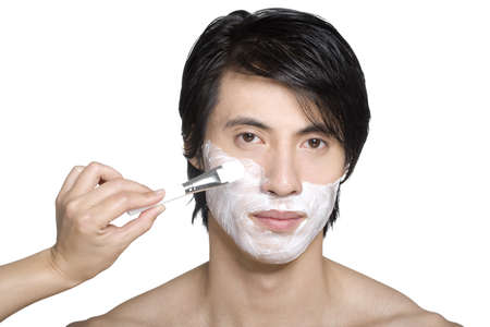 self conceit: Handsome young man with facial mask LANG_EVOIMAGES