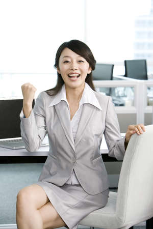 legs crossed at knee: Office worker at her desk