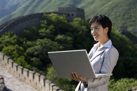 Businesswoman working on the Great Wall