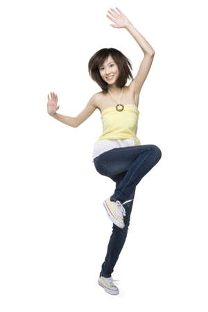 cheer full: Young woman in mid-air LANG_EVOIMAGES