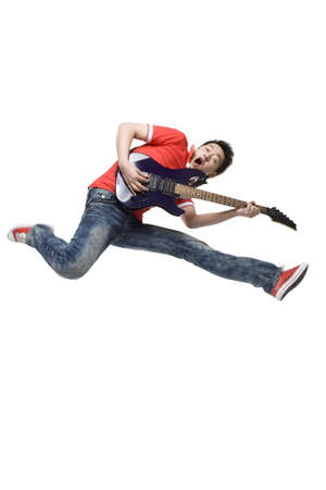 roll out: Young man playing an electric guitar