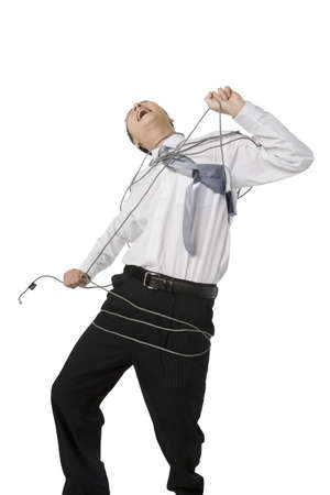 cable tangle: Businessman bound by cables