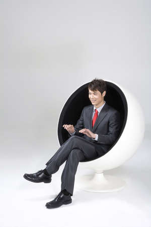 legs crossed at knee: Young businessman typing