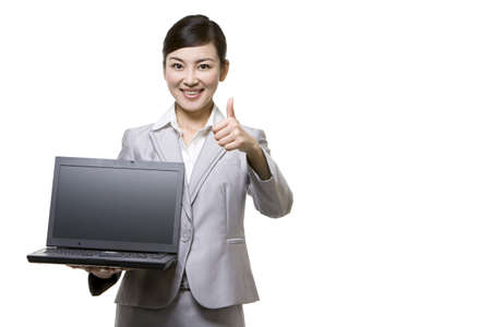 world at your fingertips: Businesswoman holding laptop
