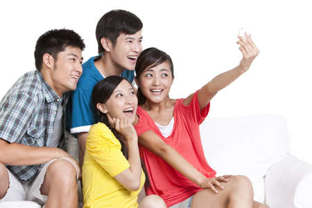 Young people posing for a picture on a cell phone