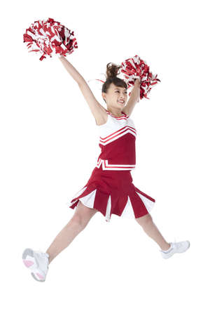 mini jack: Cheerleader in action with her pom-poms LANG_EVOIMAGES
