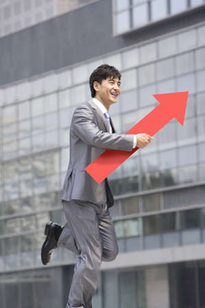 Chinese businessman with a red arrow LANG_EVOIMAGES