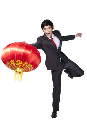 Excited Businessman Holding a Chinese Lantern