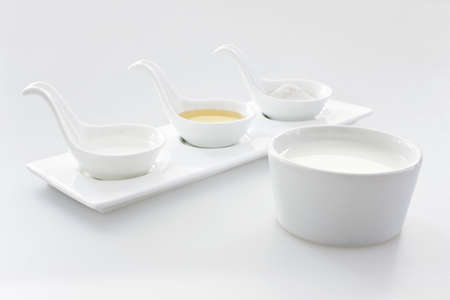 four objects: Spoons and milk