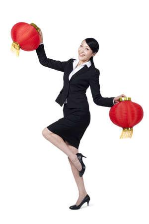 legs apart: Happy Businesswoman Holding Chinese Lanterns