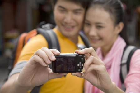 Young Couple Taking a Self-Portrait LANG_EVOIMAGES